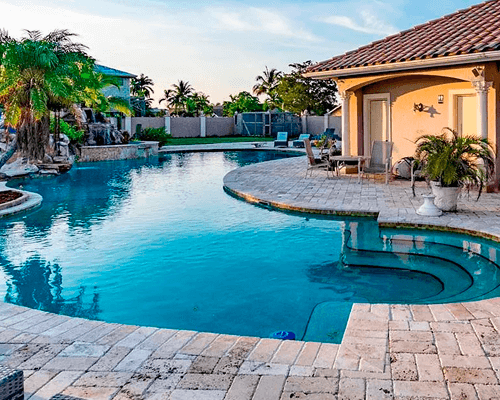 House with clean pool in Lauderhill, Florida by Urban Pool Services