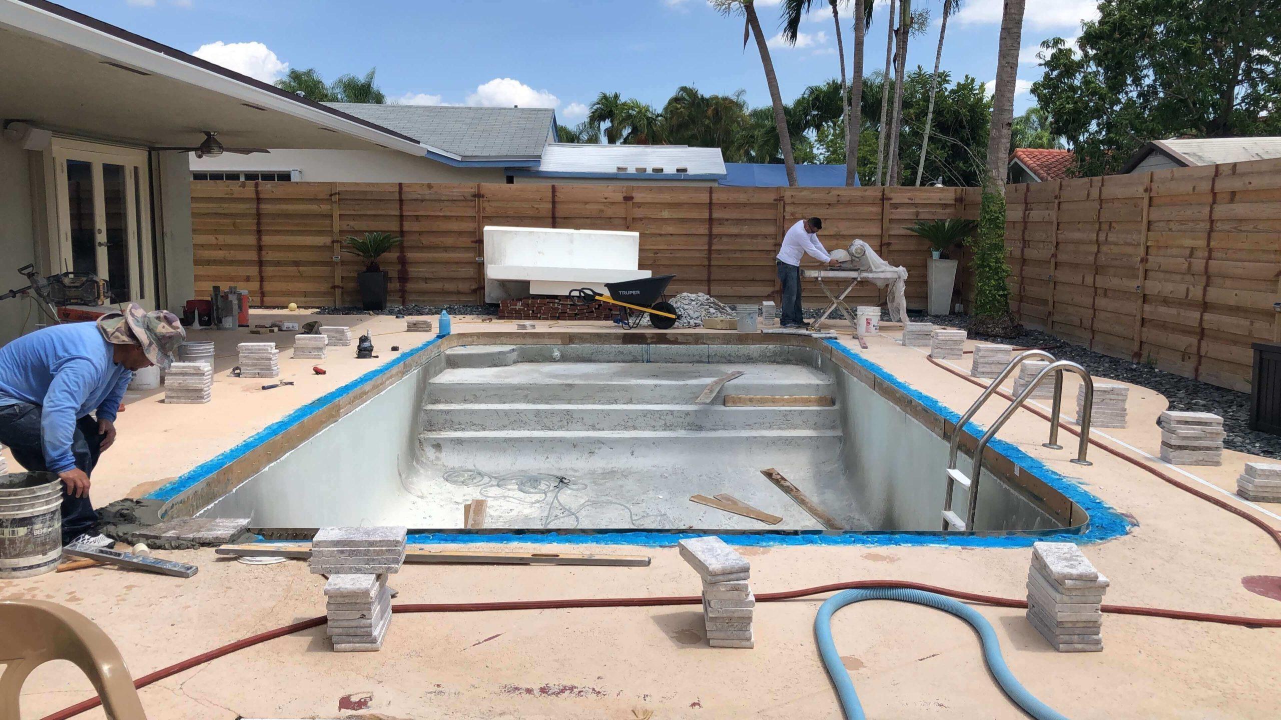 people working on pool remodeling