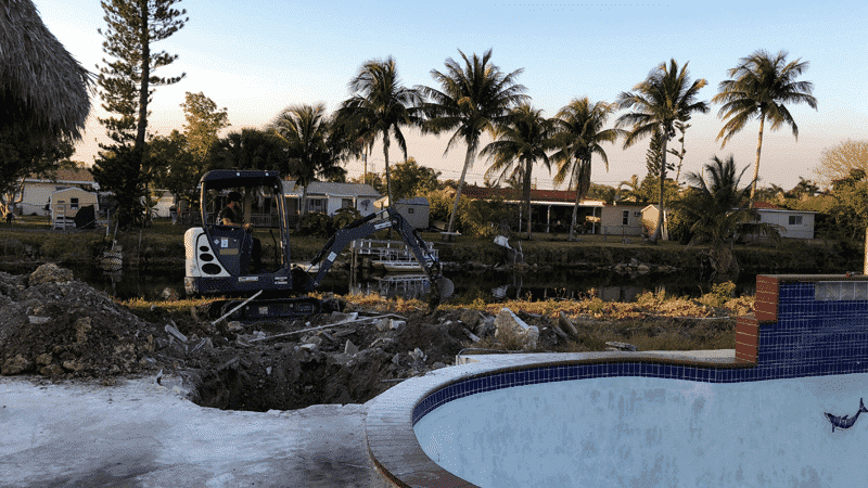Machinery in patio remodeling process