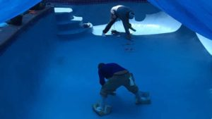 urban pool services professionals remodeling a swimming pool in South Florida