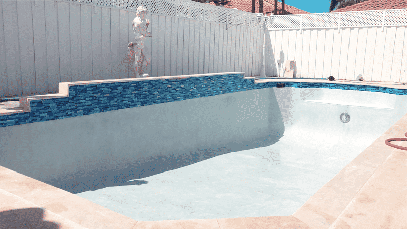 Pool Resurfacing is a swimming pool with sculptures