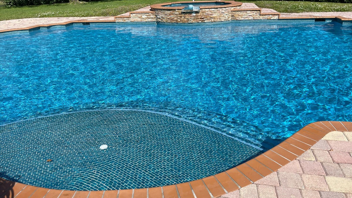 pool vacuuming by urban pool services post